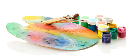 wooden art palette with paint and brushes isolated on white Stock Photo - 16439991