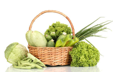 fresh green vegetables in basket isolated on white photo