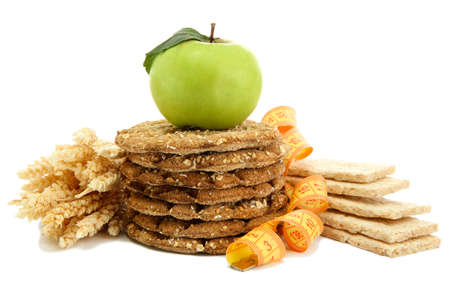tasty crispbread, apple, measuring tape and ears, isolated on white Stock Photo - 16422833