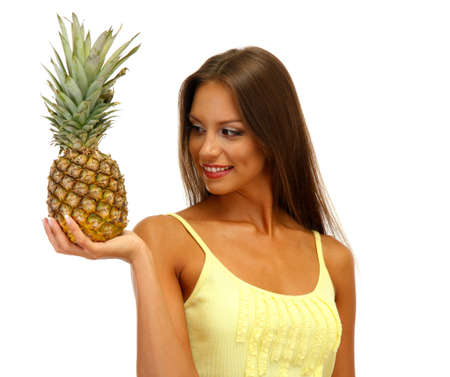beautiful young woman with pineapple, isolated on white Stock Photo - 16546462