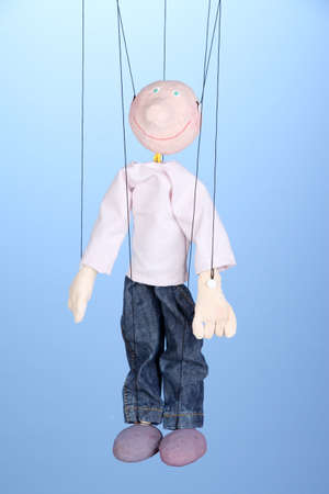 Wooden puppet on blue background Stock Photo - 16468696