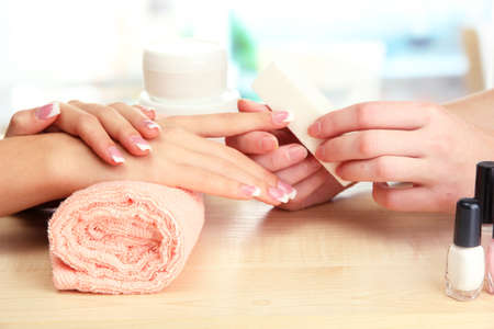 pampering: Manicure process in beauty salon, close up