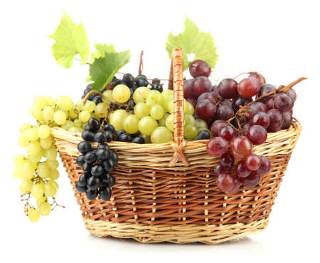 assortment of ripe sweet grapes in basket, isolated on white  photo