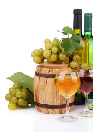 Barrel, bottles and glasses of wine, grapes, isolated on white photo