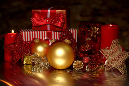 Christmas decoration and gift boxes on dark background photo