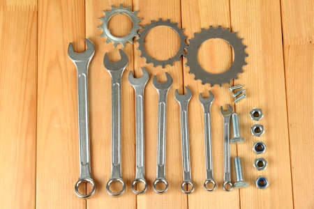 Machine gear, metal cogwheels, nuts and bolts on wooden background Stock Photo - 16472908