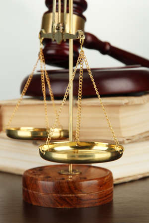 Golden scales of justice, gavel and books on grey background Stock Photo - 16472876
