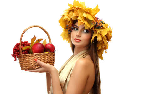 beautiful woman with wreath and basket with apples and berries, isolated on white Stock Photo - 16547177
