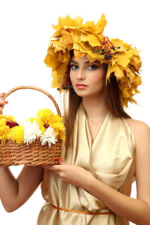 beautiful young woman with yellow autumn wreath and basket with flowers, isolated on white Stock Photo - 16547189