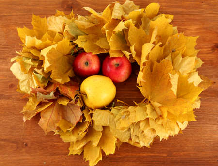 Autumnal composition with yellow leaves, apples on wooden background Stock Photo - 16473119