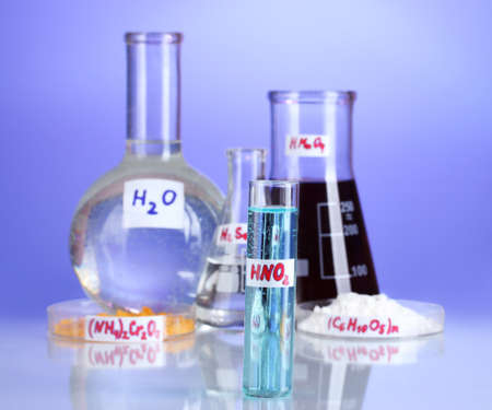 Test-tubes with various acids and chemicals on violet background Stock Photo - 16472853