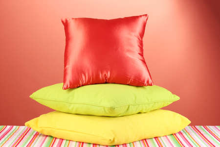 pillows on red background Stock Photo - 16501135