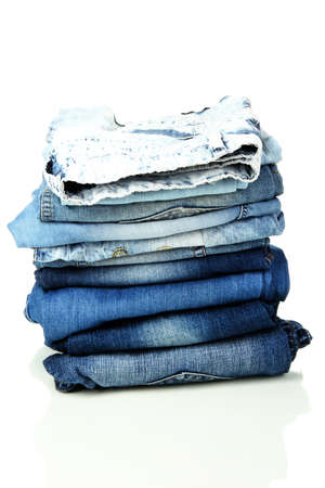 Lot of different blue jeans isolated on white Stock Photo - 16501098