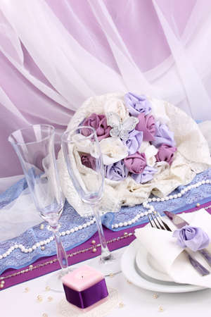 wedding table: Serving fabulous wedding table in purple color on white fabric background Stock Photo