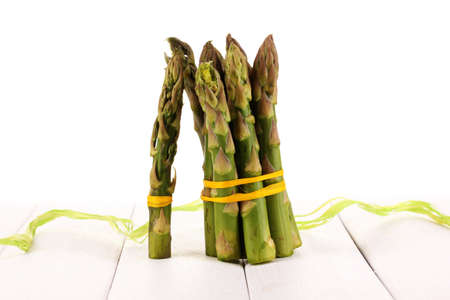 nutritiously: Useful asparagus on wooden table on white background