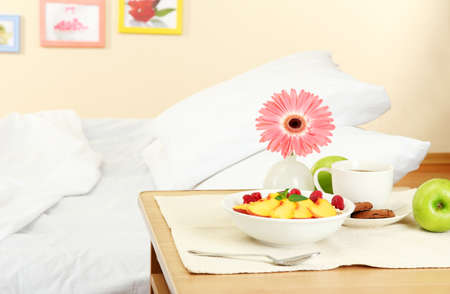 light breakfast on the nightstand next to the bed Stock Photo - 16500131