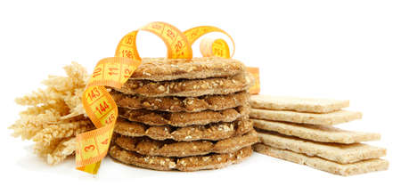 tasty crispbread, measuring tape and ears, isolated on white Stock Photo - 16500006