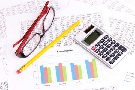 credit report: Documents, calculator and glasses close-up
