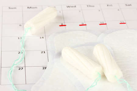 menstruation calendar with sanitary pads and tampons, close-up Stock Photo - 16500160