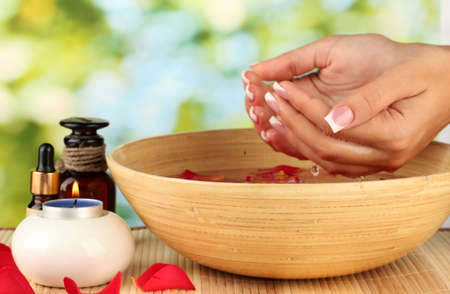 body care: spa treatments for female hands,  on green background