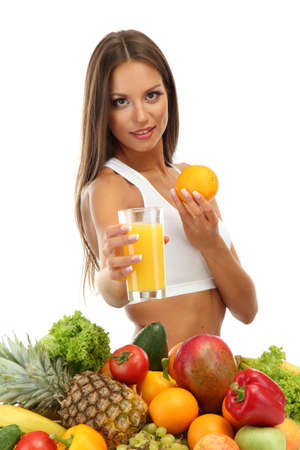 beautiful young woman with fruits and vegetables and glass of juice, isolated on white Stock Photo - 16546346