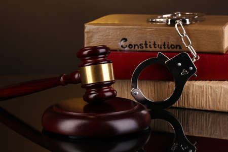 Gavel, handcuffs and books on law isolated on black Stock Photo - 16500601