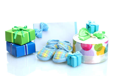 beautiful gifts, baby's bootees, blank postcard and dummy isolated on white photo