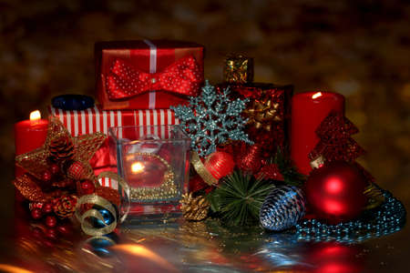 christmas beads: Christmas decoration and gift boxes on dark background