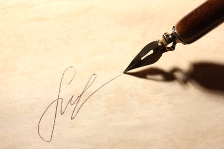 subscribing: Closeup of signature (fake, not real) and ink pen, on old paper Stock Photo