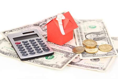 Small house and money isolated on white photo