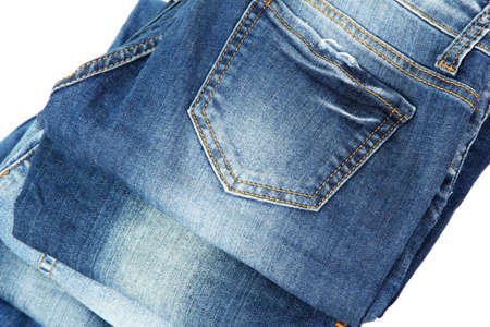 Lot of different blue jeans close-up isolated on white photo