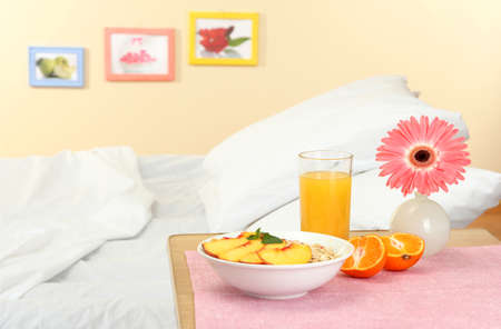light breakfast on the nightstand next to the bed Stock Photo - 16545932