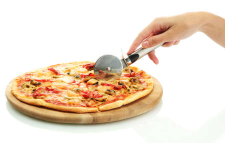 woman's hand with a knife cut the pizza on white background close-up Stock Photo - 16545467