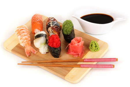delicious sushi served on wooden board isolated on white photo