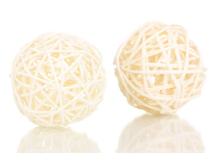 entwined: wicker bamboo balls isolated on white Stock Photo