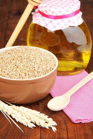 Wheat bran with honey on the table photo