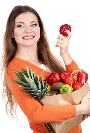 Woman holding a grocery bag full of fresh vegetables and fruits isolated on white Stock Photo - 17282233