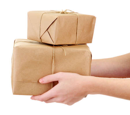 delivery package: parcels boxes in woman hands, isolated on white Stock Photo