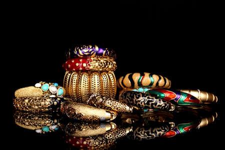 Beautiful golden bracelets isolated on black background Stock Photo - 16546037