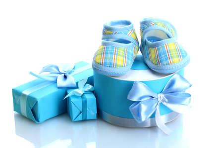 bootees: beautiful gifts and babys bootees isolated on white