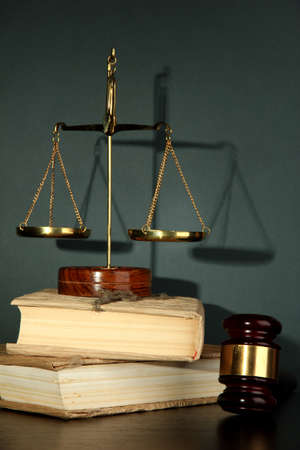 Golden scales of justice, gavel and books on grey background Stock Photo - 16570879