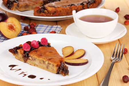 Tasty pie on plate on wooden table Stock Photo - 16562149