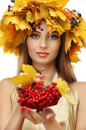 beautiful young woman with yellow autumn wreath and viburnum, isolated on white Stock Photo - 17051683