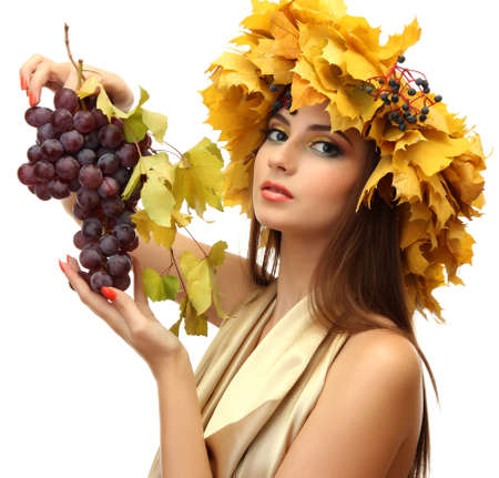 beautiful young woman with yellow autumn wreath and grapes, isolated on white Stock Photo - 17051636