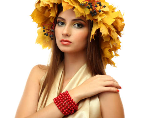 beautiful young woman with yellow autumn wreath and beads, isolated on white photo