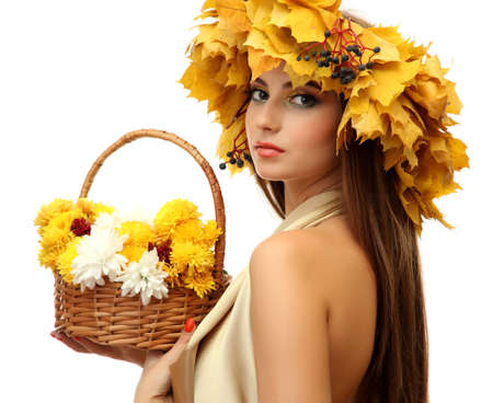 beautiful young woman with yellow autumn wreath and basket with flowers, isolated on white Stock Photo - 17051638