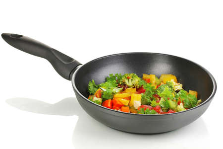 panful: Sliced fresh vegetables in pan isolated on white Stock Photo