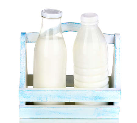 dairying: Milk in bottles in wooden box isolated on white