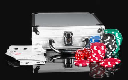 Poker set on a metallic case isolated on black background Stock Photo - 16569765