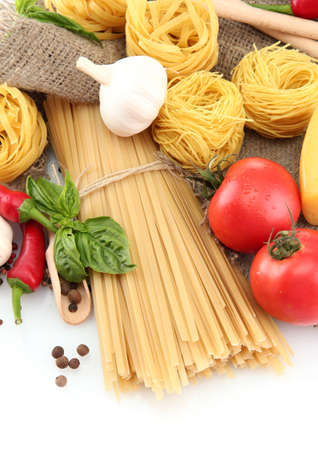 Pasta spaghetti, vegetables and spices, isolated on white Stock Photo - 16569799